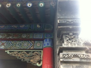 Ornamental timber and stone carvings