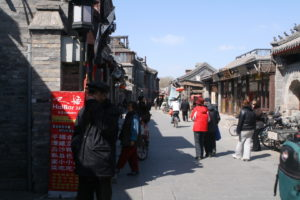 A bustling commercial area of a Beijing hutong. Photo by: Geoff McKim
